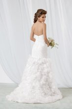 Style #M165 Shown in Diamond White…Softened sweetheart neckline. The full petaled skirt of organza and tulle, with its chapel train, billows with every step. Removable spaghetti straps are included. Available with a lace-up or zipper back. Belt, style EB01, is sold separately.