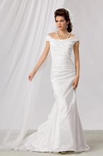 Style #M166 Shown in Diamond White…A softly draped Bridal Taffeta gown with a portrait neckline. Ruffles explode into a chapel train and the back is further enhanced with covered buttons and loops down the back, concealing the zipper. Belt, style EB05, is sold separately.