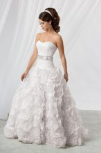 Style #M178 Shown in Diamond White…Luxe Organza ball gown with chapel train. Draped & pleated bodice with softened sweetheart neckline. Covered buttons & loops to hide the zipper. Removable spaghetti straps are included. Available with a lace-up or zipper back. Belt, style ED08, is sold separately.