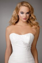 Style #M207 Shown in Diamond White…Long, fitted, pleated organza bodice with beaded details and softened sweetheart neckline. Organza rosette skirt with chapel train. Buttons and loops on center back. Removable spaghetti straps included.