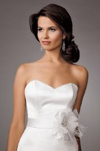 Style #M244 Shown in Diamond White…Classic Princess line satin gown with sweetheart neckline. Buttons and loops down back of chapel train. Also included with gown are removable flounced shoulder treatment and separate sash so that you can customize your look!