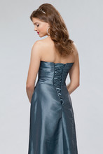Style #654 Back Shown in Copen…Draped taffeta gown with trumpet skirt. Lace up back. Removable spaghetti straps included. Available in short, knee and floor lengths.