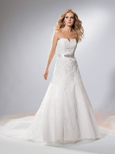 Reflections By Jordan M318 Shown in Diamond White…Fit and flare tulle gown with lace accents and sweetheart neckline. Chapel train. Separate ribbon sash with rhinestone applique. Removable spaghetti straps included.