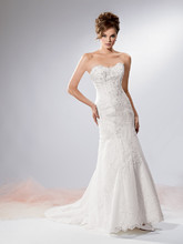 Reflections By Jordan M337 Shown in Diamond White…Embroidered lace fit and flare gown with softened sweetheart neckline and chapel train. Buttons and loops over zipper. Removable spaghetti straps included.