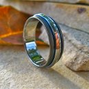 Sable is a texture much like a matte or a satin finish and will be subject to wear just as any finish will wear on any precious metal. These are titanium rings in the tones of twilight, sleek and powerful, perfect as promise rings or wedding bands.