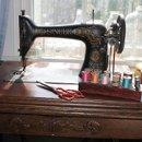 130x130 sq 1328925010898 antiquesingersewingmachine