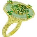 Large Oasis Green Jade RingLarge green jade ring with diamonds and center of faceted peridot, set in 18k yellow gold.