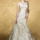 Virgo  <br /> Strapless fit and flare gown with a perfectly pleated bodice that trancend into a dramatic draping