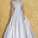 AMADEA  A classic ballgown featuring a full skirt with box pleats An exquisite bodice encrusted with the fine beadwork make this dress stand out above the rest!