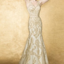 ORION  This classic fit and flare, substainable lace gown features plunging neckline and sheer lace back with covered buttons elegant, hand beaded detail highlights the natural wasitline.