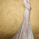 RIGEL  Substainable Chantilly lace, fit and flare gown with elegant sheer neckline and long sleeves, sultry jewel encrusted low back adds a modern touch of this traditional gown.