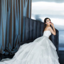 Yumi Katsura Couture Style Atalanta  This dramatically embellished bodice of exquisitely hand beaded Swarovski crystals and the finest natural stones, tops a soft, yet dramatic ballgown skirt.