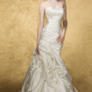 VIRGO  Strapless fit and flare gown with a perfectly pleated bodice that trancend into a dramatic draping.