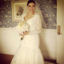 Pronovias wedding gown with lace jacket and Toni Federici veil.