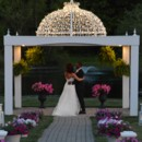 The couple have their first dance under the gazebo as the sun in setting. Very sweet.