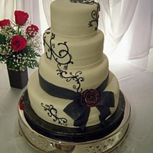 220x220 sq 1326160756989 blackrose3weddingcakers11