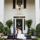 130x130 sq 1450817378936 bride and groom on front porch sitting black door