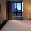 130x130 sq 1450453366009 suitekingbedroom6316