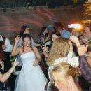 130x130_sq_1266779030706-weddingpic8