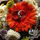 130x130 sq 1221840864337 ringflowers