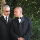 130x130 sq 1444292798701 rev. perry talking to groom
