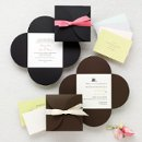 Petal Wrap - Anticipation grows as each petal unfolds to announce your special day. This invitation set includes everything you need to share your exciting news and assembly is a breeze. Exclusively Weddings offers your choice of five reception card paper colors: Pink, Citron, Teal, Bright White and Antique White. The wrap is available in your choice of Black or Brown. Satin ribbon, in a wide array of colors, is sold separately. Order Your Free Sample Today!