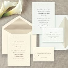 Calla Lily Beauty - Artfully embossed calla lilies border this classic non-folding wedding invitation. Exclusively Weddings offers this invitation in three classic paper colors: Bright White, Soft White and Ecru. Matching thank you note cards are also available in Soft White and Ecru only. Order Your Free Sample Today!