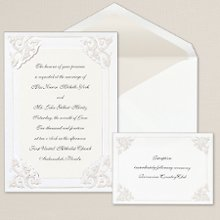 Dynasty Corners - An elaborate corner design adds an elegant touch to this non-folding card from Exclusively Weddings. Your invitation wording is printed on a vellum overlay that slips under each decorative corner. Order Your Free Sample Today!
