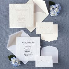Old World Elegance - This traditional non-folding card with intricate border design gives your wedding invitation an elegant, Old World look. Exclusively Weddings offers this large, square invitation in your choice of bright white or ecru card stock. Order Your Free Sample Today!