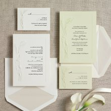 Calla Lovely - Sheer elegance and style is showcased in the Calla Lovely Wedding Invitation design in which an embossed calla lily frames the left side of this classic invitation. The deeply embossed border adds further texture. Exclusively Weddings offers your choice of traditional white or a soft willow green textured card stock. Order Your Free Sample Today!
