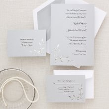 Nature's Love - Create an impression both naturalistic and elegant with this chic leaf-and-vine pattern invitation, designed by Exclusively Weddings. The motif is embossed in silver foil, giving the design a soft metallic sheen and a bit of intriguing dimension. The design coordinates perfectly with the large selection of accessories in our Nature's Love collection. Order Your Free Sample Today!