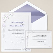 Calla Lilies - A traditional wedding invitation featuring classic calla lilies embossed on bright white card stock. Simply select the wedding invitation wording that perfectly fits your style. Exclusively Weddings offers this invitation accented in your choice of purple or wine. Order Your Free Sample Today!