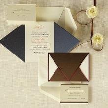 Wrapped in Love - The rich metallic folder of this bold invitation set wraps around the ensemble components. A soft metallic band edging the folder, accentuating its crisp lines, is repeated on all the matching pieces. Exclusively Weddings offers the invitation wrap in your choice of bronze or onyx. Order Your Free Sample Today!
