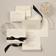 Elegant Damask - A stunning damask pattern with floral accents adorns the outside of this wedding invitation in a traditional ecru paper stock. To coordinate your wedding day theme or color, a piece of pre-cut satin ribbon is included. Also available in bright white paper stock. Order Your Free Sample Today!