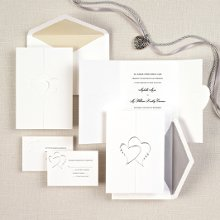 Diamond Romance - This noteworthy folded card opens to reveal your wedding invitation wording and closes with the two hearts joined together as one ... perfect symbolism for your wedding day. Available with your choice of pearl or silver accent colors. Order Your Free Sample Today!
