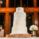 130x130 sq 1449567092543 fondant rosette cake