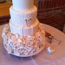 220x220 sq 1449567322969 sugar flowers and cornelli lace cake