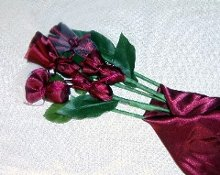 220x220 1176868420750 chocolateflowerfavor025asmallwebview