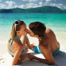 130x130 sq 1431556836392 romantic couple kissing on beach