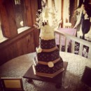 Ganache wedding cake Bottom layer: Chocolate cake with mocha cream Middle layer: Strawberry cake with Bavarian cream Top layer: Vanilla cake with fresh raspberry compote