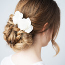 130x130 sq 1447681370455 bridal messy low bun