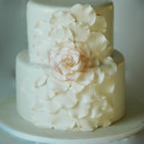 Exploded flower design wedding cake, sugar flower lightly dusted with coral color.