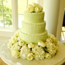 Mint buttercream wedding cake with scrolls and fresh hydrangeas, peonies and roses