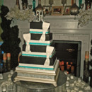 130x130 sq 1421262467895 black with turquoise and rhinestone wedding cake