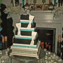 130x130 sq 1421262467895 black with turquoise and rhinestone wedding cake