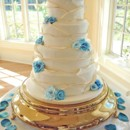 130x130 sq 1421262487240 blue roses gold edged ruffle wedding cake