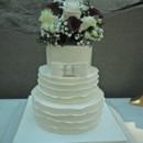130x130 sq 1421262649822 fondant ruffles and bow wedding cake
