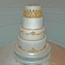 130x130 sq 1421262720973 gold molding and trim wedding cake