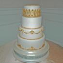 130x130 sq 1421262720973 gold molding and trim wedding cake