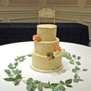 130x130 sq 1421263199682 rustic buttercream wedding cake with garland and f